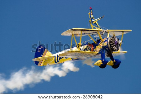 FAIRFORD, UNITED KINGDOM - JULY 15: The Utterly Butterly wing walking team performs at the Royal International Air Tattoo July 15 and 16, 2006 in Fairford. - stock photo