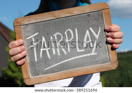 FAIRPLAY written with chalk on writing slate shown by young female