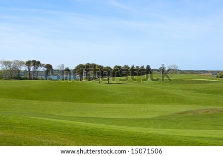 Fairway at golf course, country club with manicured lawn, overlooking ocean - stock photo