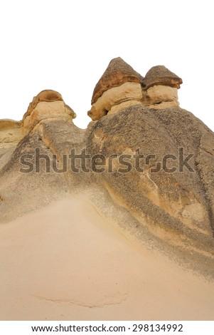 Fairy Chimneys in Cappadocia Nevsehir Turkey isolated on white - stock photo