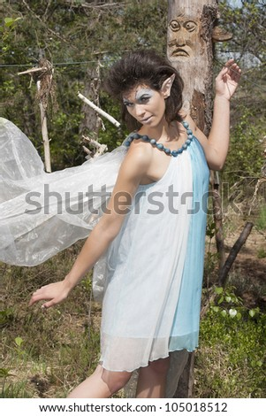 Fairy floats past a tree spirit /floating elf - stock photo