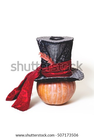 Fairy hat. High cylinder hat with ribbon and pen wearing a big ripe pumpkin