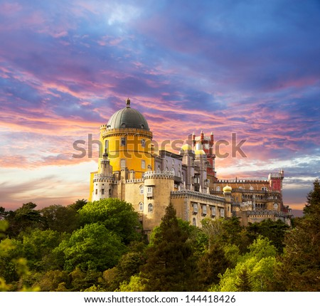 Fairy Palace against sunset sky /  Panorama of Pena National Palace in Sintra, Portugal / Europe - stock photo