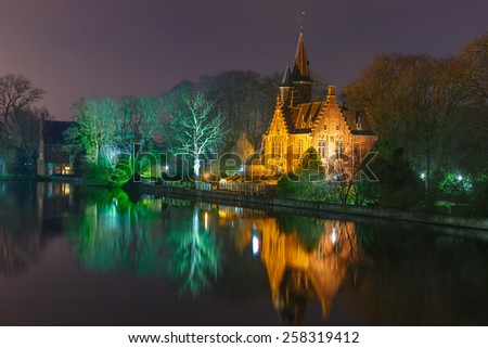 Fairytale night landscape with a medieval house on Lake Minnewater in Bruges, Belgium - stock photo