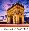 Fairytale sunset over famous Arc de Triumph with blurred traffic lights, Paris, France - stock photo