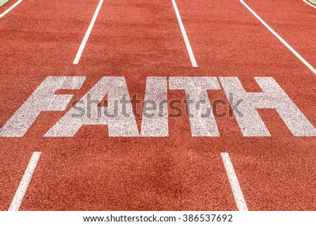Faith written on running track - stock photo
