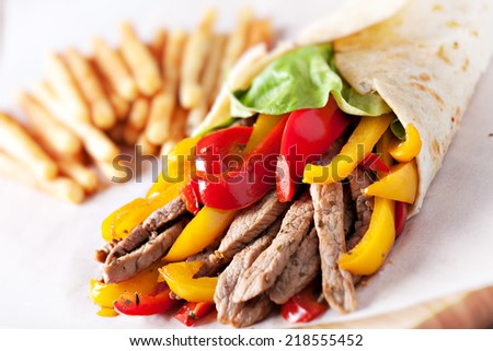 Fajitas with fries - stock photo