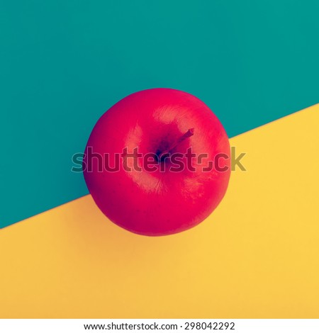 Fake Apple in red paint. Minimal style - stock photo