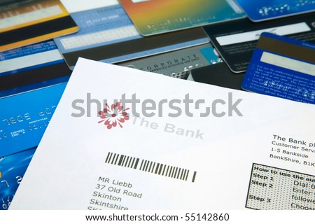 Fake bank statement on top of a selection on bank and credit cards - stock photo