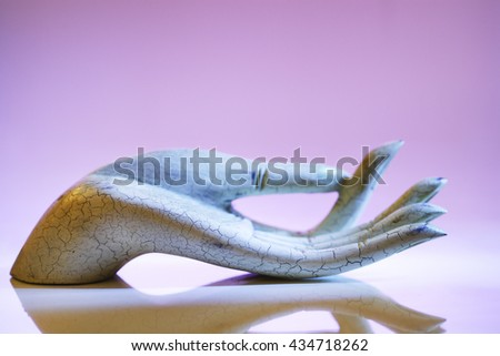 FAKE BUDDHA'S HAND BLESSING OR BESTOWING GIFTS  - stock photo