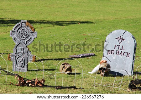 Fake cemetery with graves and crosses, a decoration for Halloween. - stock photo