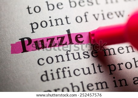 Fake Dictionary, definition of the word puzzle. - stock photo