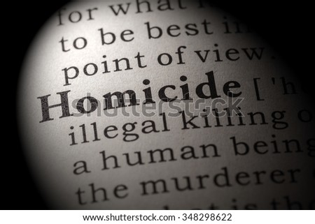 Fake Dictionary, Dictionary definition of the word homicide  - stock photo