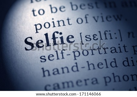 Fake Dictionary, Dictionary definition of the word selfie. - stock photo
