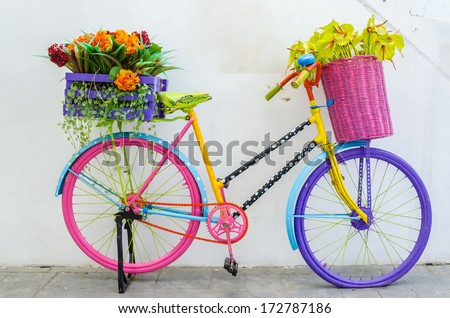 Fake flower in the vase on a bicycle - stock photo