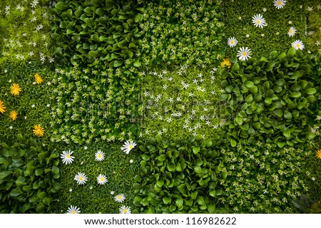 fake grass and flower wall - stock photo
