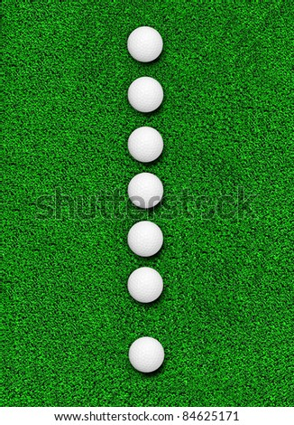 Fake grass and golf ball line as Exclamation symbol