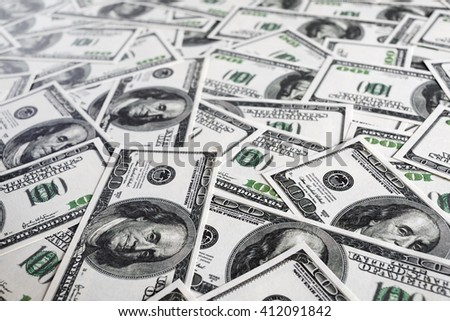 Fake money background. Business concept. Pile of one hundred dollar bills. Shallow depth of field. Selective focus. - stock photo