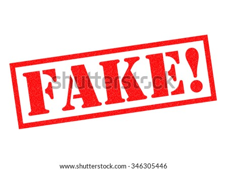 FAKE! red Rubber Stamp over a white background. - stock photo