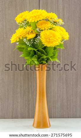 Fake yellow flower vase table marble stock photo royalty free fake yellow flower in vase at table marble on wooden background mightylinksfo Images