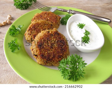 Falafel burger with herb yogurt  - stock photo