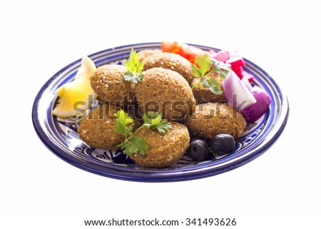 Falafel is a traditional Middle Eastern food made with ground chickpeas, fava beans, or both - stock photo
