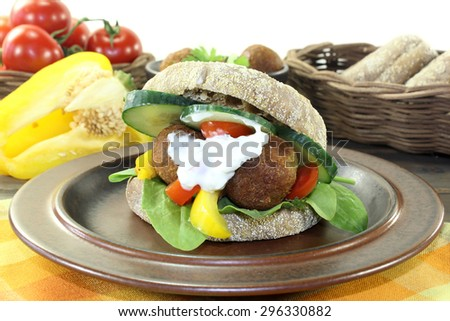 Falafel with fresh salad on a light background - stock photo