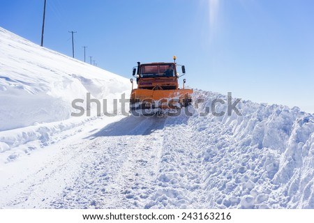 FALAKRO, GREECE - FEBRUARY 11, 2013: Snowmobile moving snow to clear the roads in Falakro ski center, Greece. The ski resort of Falakro Mountain is located in the area of Dramas.