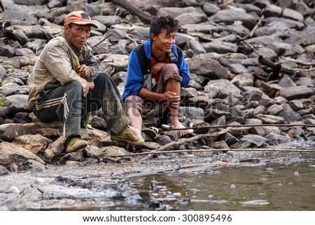 FALAM, MYANMAR - JUNE 17 2015: Fisherman at the start of the monsoon season in the recently opened to tourists Chin State region of Western Myanmar (Burma) - stock photo
