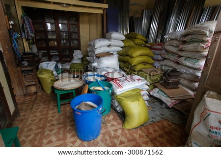 FALAM, MYANMAR - JUNE 18 2015: Rice supplier in Falam Town in the recently opened to foreigners area of Chin State - western Myanmar (Burma) - stock photo