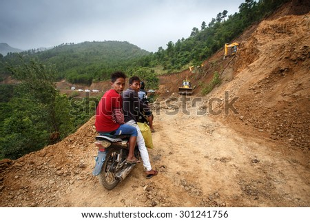 FALAM, MYANMAR - JUNE 17 2015: Road construction in the recently opened to foreigners area of Chin State - western Myanmar (Burma) - stock photo