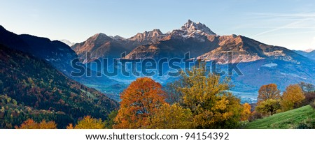 Fall alpine panoramic view Dents du Midi from near Villars - stock photo