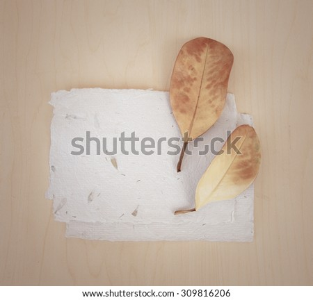 Fall background with yellow autumn leaves, acorns over wooden table surface, Thanksgiving background in retro style  - stock photo