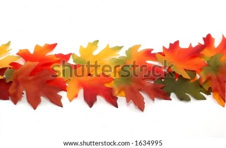 Fall colored fabric leafs - border- small - stock photo