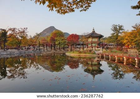Fall colors at the Hyangwon Jeong Pavillion at the Gyeongbokgung Palace in Seoul, South Korea  - stock photo