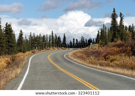 Fall comes to the Alaska Highway System of transportation  - stock photo