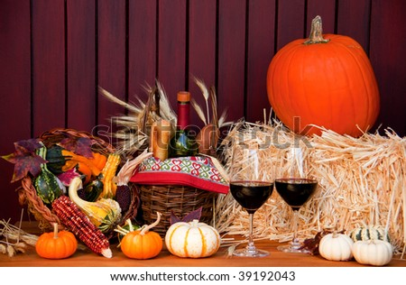 Fall cornucopia and wine setting - stock photo
