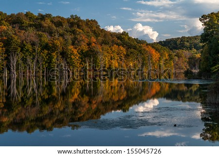 Fall foliage colors reflected on Monksville Reservoir, New Jersey - stock photo