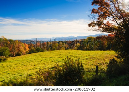 Fall foliage mountain range, Stowe Vermont, USA - stock photo