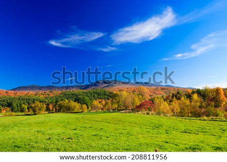 Fall foliage mountain range, Stowe Vermont, USA - stock photo