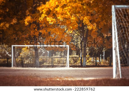 fall football and soccer goal. Soccer sunset. Football in the sunset - stock photo