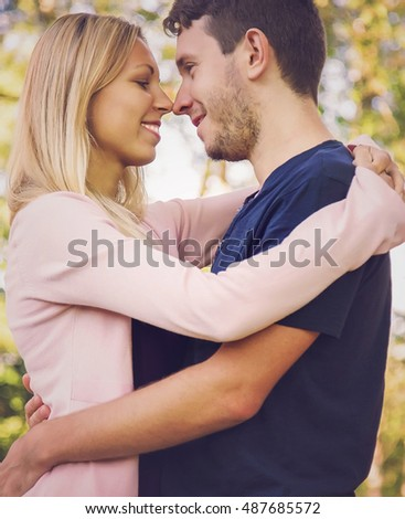 Fall in love, young couple hug each other.
