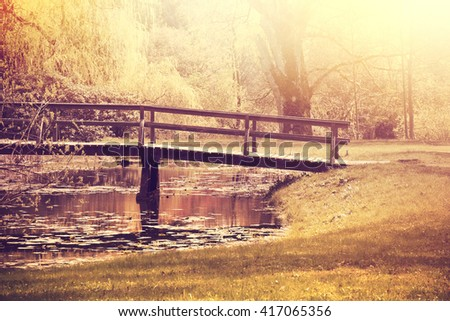 Fall in the park. Autumn nature in vintage retro colors. - stock photo