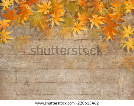 Fall leaves on wooden planks - autumn design - stock photo