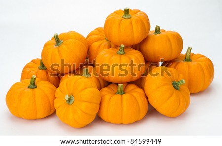 Fall or Autumn or Halloween pumpkins stacked for decoration on white