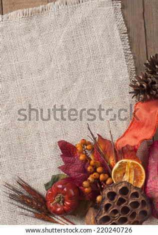 Fall Season card with Nature Elements in Rustic Setting with Burlap and old wood background from above with empty room or space for copy, text, your words, vertical. - stock photo
