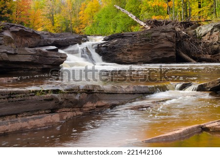 Fall stream and waterfall - stock photo