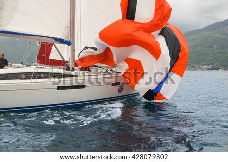 "Fallen sail on a yacht. Tivat, Montenegro - 27 April, 2016 Regatta ""Russian stream"" in God-Katorskaya bay of the Adriatic Sea off the coast of Montenegro. - stock photo"