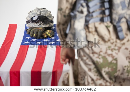 Fallen soldier - Military funeral in a white studio - stock photo