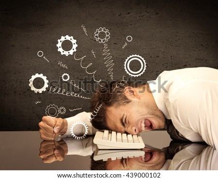Falling apart illustration concept with cranks, cog wheels springing from a fed up and tired businessman's head resting on laptop keyboard - stock photo